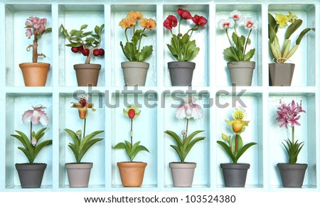 Colorful clay flower in flower cabinet