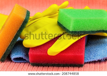 Colorful cleaning products including sponges, gloves and towels