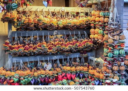 Colorful close up details of christmas fair market. Balls  with a slice of orange decorations for sales.