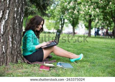 Colorful Close Up of using tablet in the park. - stock photo