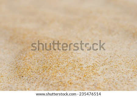 Colorful closeup detail of de-focused wavy and rippled lines and curves of remote sandy desert or beach dune, natural design backdrop, background or wallpaper. - stock photo
