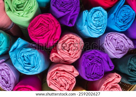 Colorful cloth rolls, blue,navy blue,indigo,green,red,violet in clothes shop. Close up and top view shot.