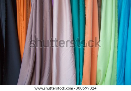 colorful clothes background. Pile of bright folded clothes. - stock photo
