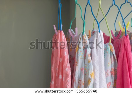 Colorful clothes hanging to dry on a laundry line