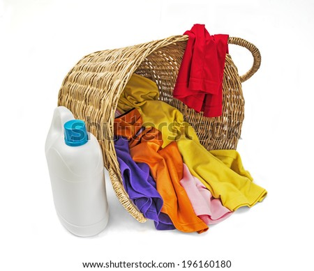 Colorful clothes in wooden laundry basket  - stock photo