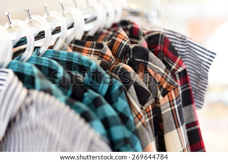colorful clothes on Hangers - stock photo
