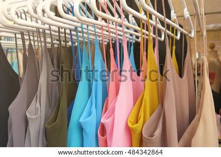 colorful clothes on hangers
