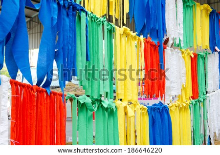 Colorful clothes on the market .