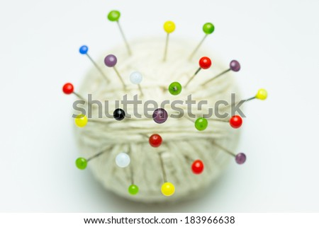 Colorful clothes pins on yarn - stock photo