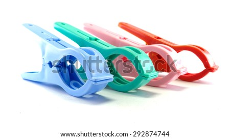Colorful clothespins isolated on white background - stock photo