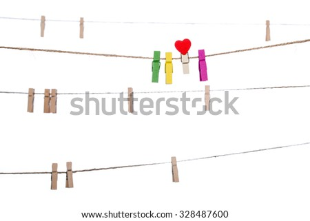 colorful clothespins with heart  shape  clip on a clothesline, valentine romantic - stock photo