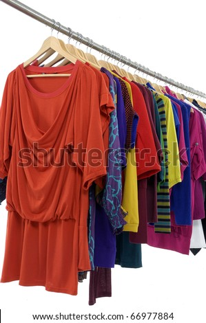 colorful clothing on hanger rack display - stock photo