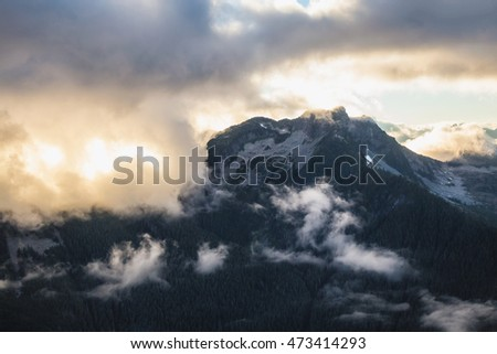 Colorful Clouds around the mountains of British Columbia, Canada. Taken during a cloudy sunset.