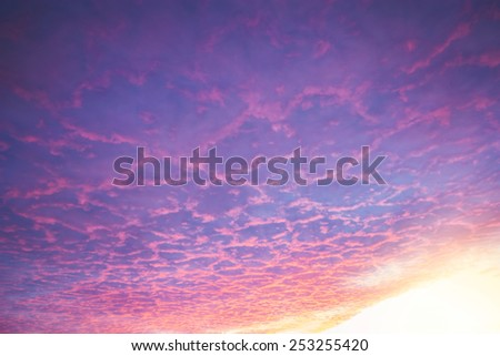 Colorful clouds on the winter evening sunset sky.  - stock photo