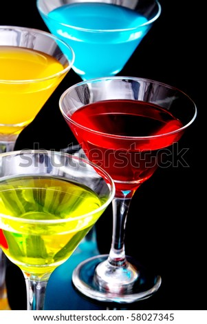 Colorful cocktail drinks in glasses - stock photo