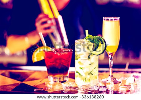 Colorful cocktail on top of the bar in Italian restaurant. - stock photo