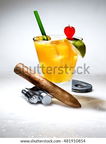 colorful cocktail with a cigar on a beautiful composition with drops and beautiful colors
