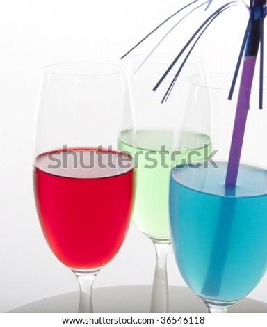 Colorful cocktails in red, green and blue with festive decoration
