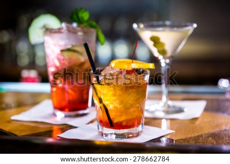 Colorful cocktails on the bar table in restaurant. - stock photo