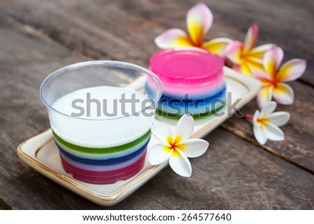 colorful coconut jelly, thai dessert on old wood background.