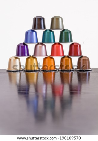 Colorful coffee capsules placed in form of pyramid - stock photo