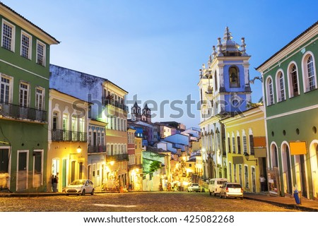 Colorful colonial houses at the historic district of Pelourinho at twilight in Salvador da Bahia, Brazil. - stock photo