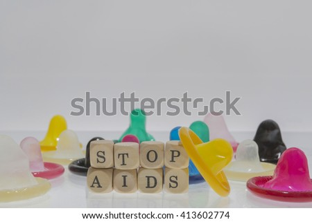 colorful condom with words stop aids - stock photo