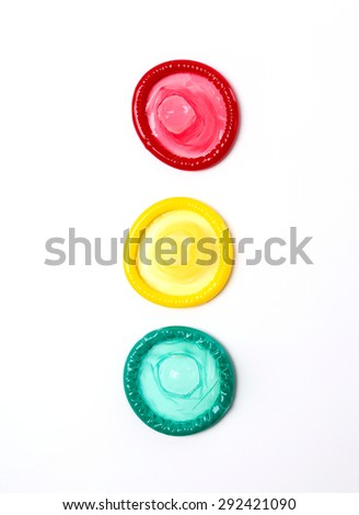 Colorful condoms on a white background
