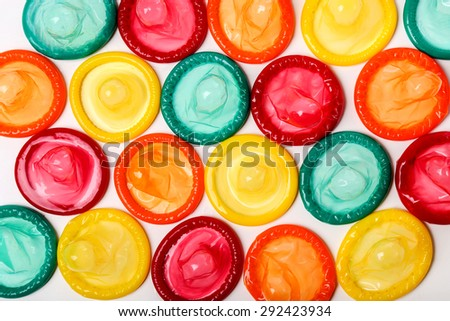 Colorful condoms on a white background - stock photo