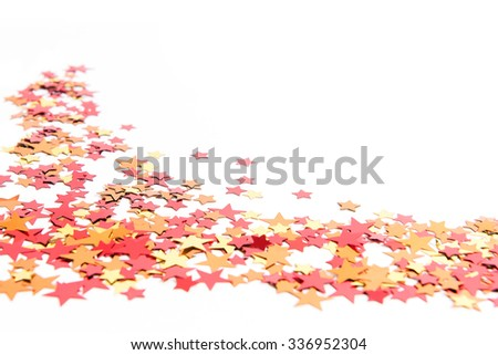 colorful confetti background. gold, red, yellow, orange - stock photo