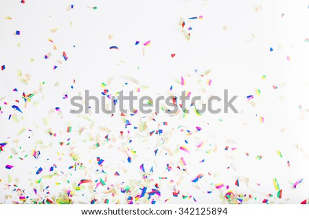 Colorful confetti on white background - stock photo