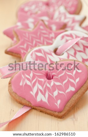 "Colorful cookies and a pink ribbon with ""Merry christmas"" written on it - stock photo"