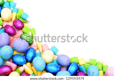 Colorful corner border of Easter candy over white - stock photo