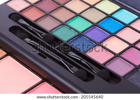 colorful cosmetic palette set eyeshadow brush makeup  - stock photo