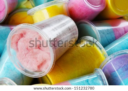 Colorful cotton candy in plastic cups - stock photo