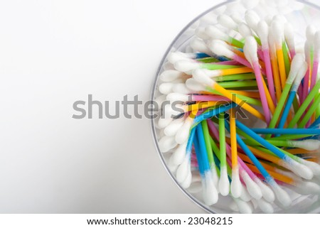 colorful cotton swabs on light background - stock photo