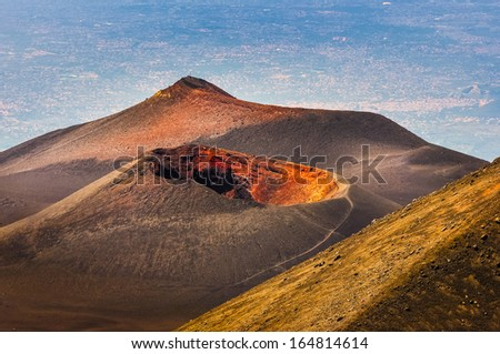 Colorful crater of Etna volcano with Catania in background, Sicily, Italy - stock photo