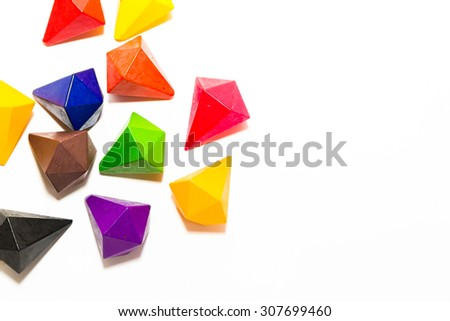 Colorful crayon pencil in shape of gem stones, isolated on white background - stock photo