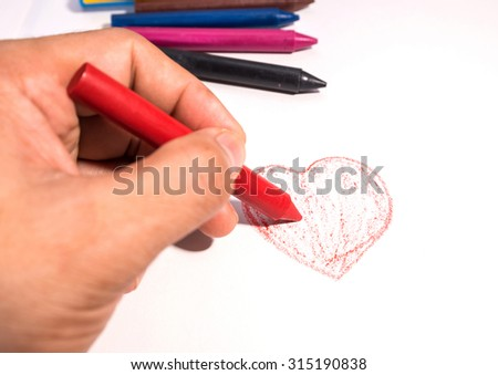 Colorful crayons painted on white book - stock photo