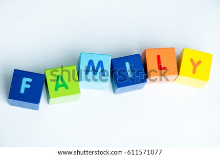 Colorful cubes with letters consists the word family  isolated on white