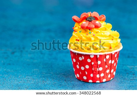 Colorful Cupcake on wood vintage background