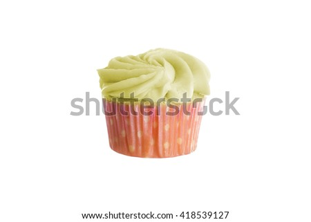 Colorful cupcake with thick frosting or icing isolated on a white background.  The cake is colored with artificial yellow food coloring.