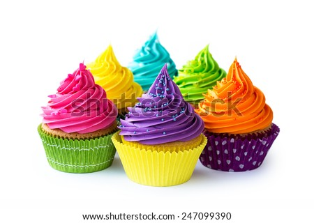Colorful cupcakes against a white background