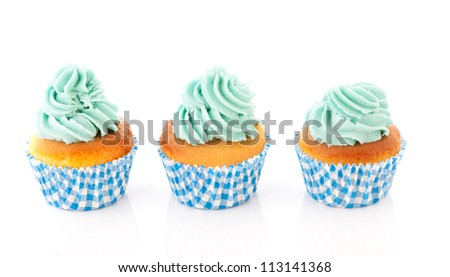 colorful cupcakes in blue with green butter cream