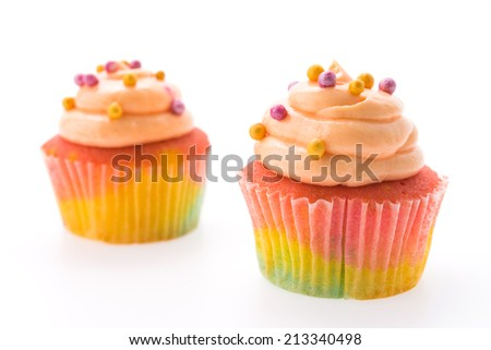 Colorful cupcakes isolated on white
