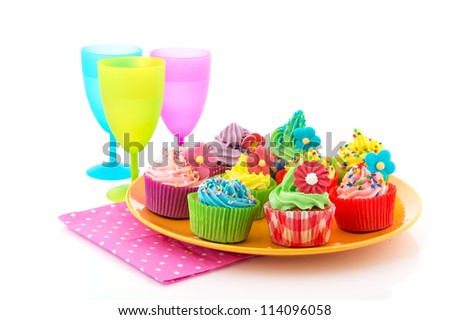 colorful cupcakes with butter cream and glasses lemonade