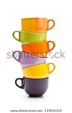 Colorful cups tower on white background - stock photo