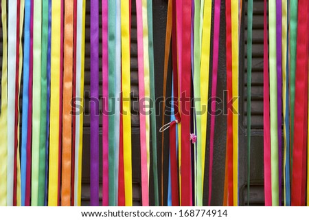 Colorful curtain of strips of decorative shiny carnival ribbon cover the entrance to a door in Jericoacoara Nordeste Brazil
