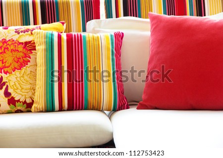 Colorful cushions in sofa.