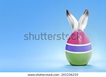 Colorful cute ceramic easter egg with rabbit ears and the flag of Gambia .(series) - stock photo